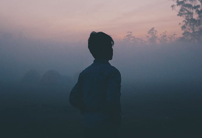 Young man in the mist